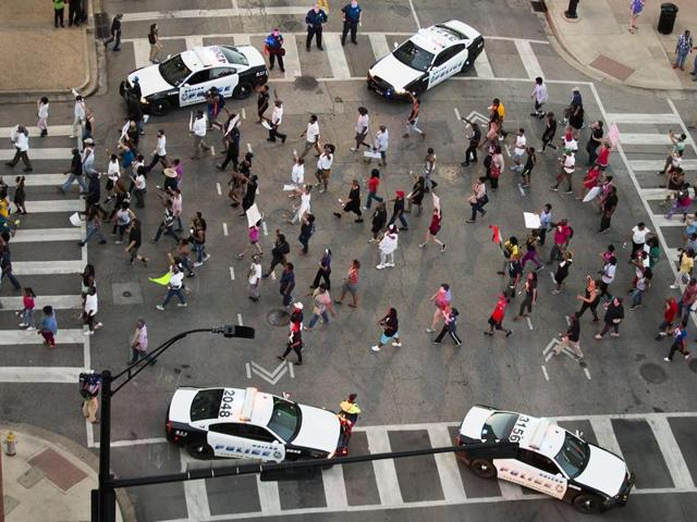 Dallas Police respond after shots were fired at a Black Lives Matter rally in downtown Dallas on Thursday.