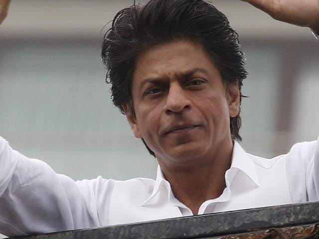 Shah Rukh Khan greets fans waiting outside his residence on Eid al-Fitr in Mumbai .