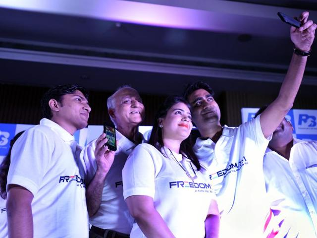 Lift to Right : Anmol Goel GM Ringing Bells, Ashok Chaddha President ringing Bells, Dharna Goel CEO Ringing Bells, Mohit Goel director Ringing Bells, click Selife with Freedom 251 smart phones, priced at Rs 251 or $3.6 at a press conference in New Delhi, India.