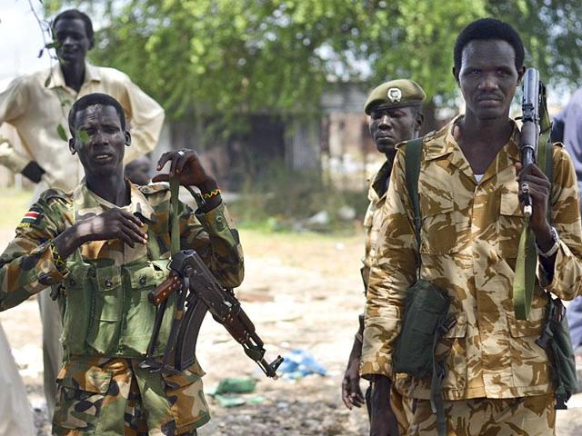 In this file photo, South Sudanese government soldiers patrol in Bentiu town, South Sudan. Heavy gunfire erupted outside the compound of South Sudan's president as Salva Kiir.