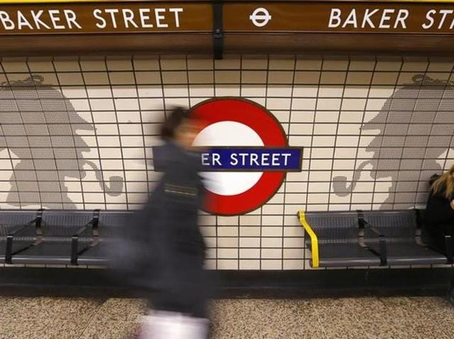 A passenger walks through Baker Street Underground station in central London.
