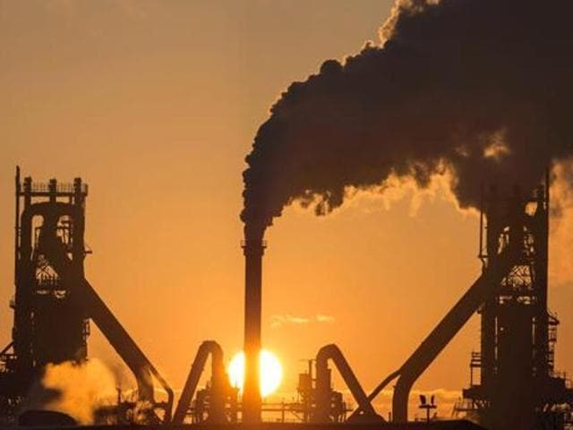 This file photo taken on March 31, 2016 shows the sun rising above Tata Steel's blast furnaces at their Scunthorpe Plant in north east England.