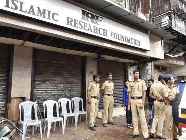 Cops outside Zakir Naik's office at Dongri in Mumbai on Thursday.