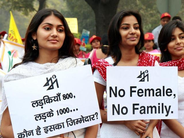LOUD AND CLEAR Volunteers during a rally against female foeticide in New Delhi.(HT Photo)