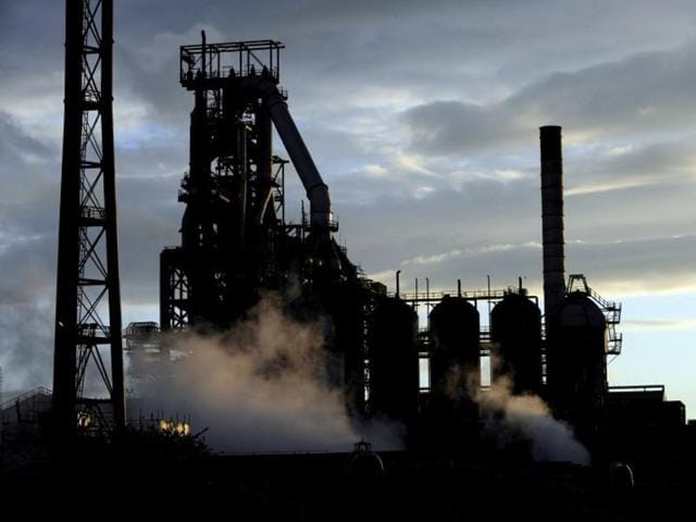 One of the blast furnaces of the Tata Steel plant is seen at sunset in Port Talbot, South Wales.
