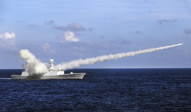 In this photo released by Xinhua News Agency on Friday, Chinese missile frigate Yuncheng launches an anti-ship missile during a military exercise in the waters near south China's Hainan Island and Paracel Islands. They are controlled by Beijing but also claimed by Vietnam and Taiwan.