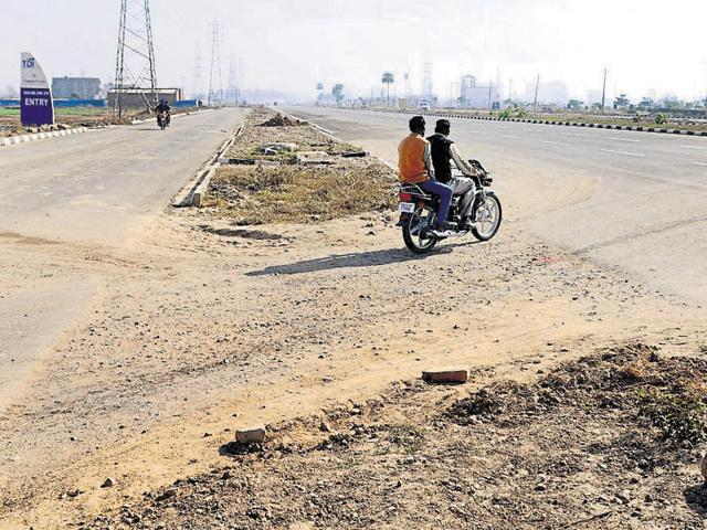 On collision course with law. A motorcycle going through a median, broken by residents of nearby localities on the airport road in SAS Nagar. It is dangerous when vehicles appear suddenly out of unexpected points.