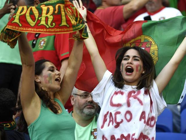 Portugal supporters wait for the start of the Euro 2016 semifinal football match between Portugal and Wales at the Parc Olympique Lyonnais stadium in Décines-Charpies, near Lyon.