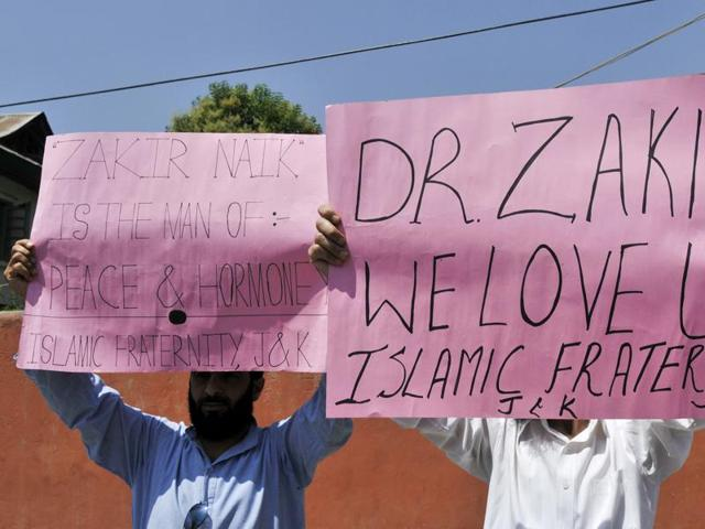 People in Kashmir take part in a demonstration in support of Islamic preacher Zakir Naik on Friday.