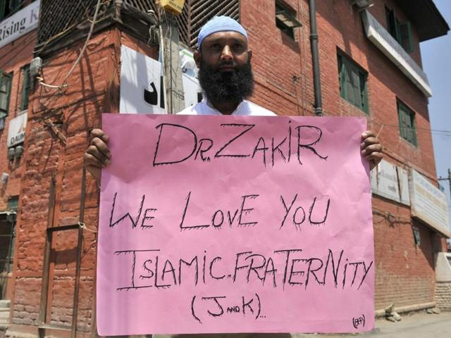 Srinagar: Supporters shout slogans and hold placards during a protest march in favour of Islamic scholar Zakir Naik in Srinagar on Friday