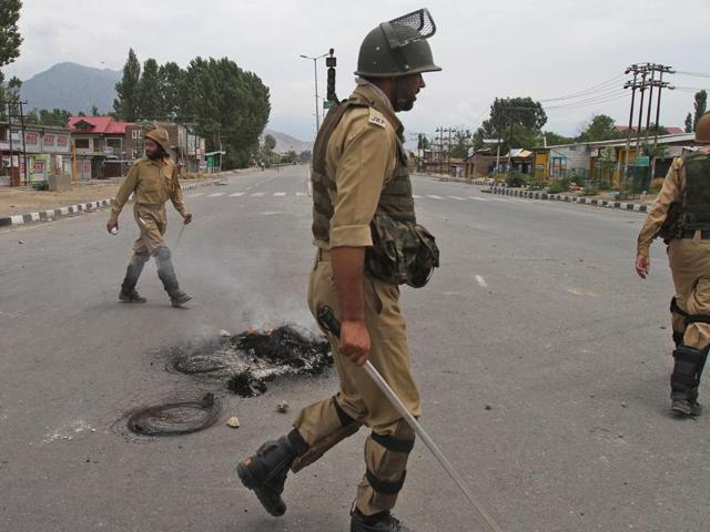 Burning tyres were set up as road blocks by Kashmiri protesters during curfew in Srinagar.