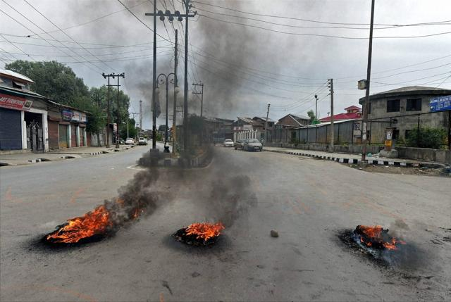 Protesters block roads by burning tyres during a protest following the killing of Hizbul Mujahideen commander Burhan Muzaffar Wani along with his two associates in Srinagar on Saturday.