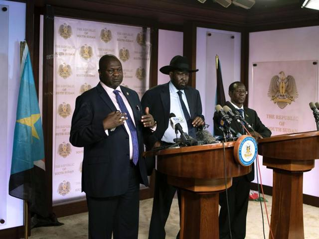 First Vice President Riek Machar (L) delivers a speech to journalists next to South Sudan President Salva Kiir (C) and Vice President James Wani Igga (R) prior to the shooting outside the presidential palace in Juba on July 8, 2016.