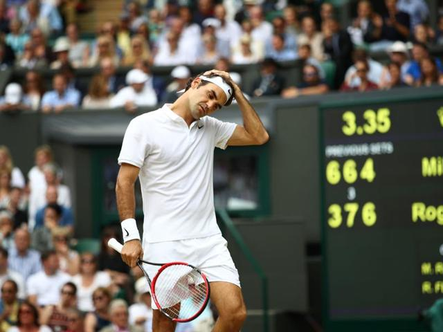 Switzerland's Roger Federer reacts after losing a point to Canada's Milos Raonic during their men's semifinal .