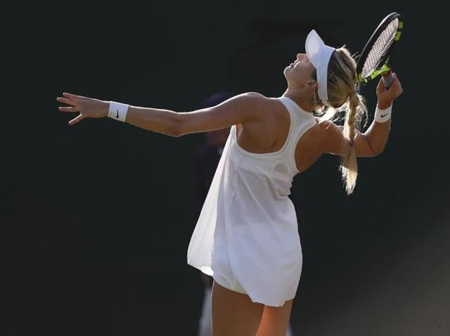 Canada's Eugenie Bouchard plays against Dominika Cibulkova at the All England Lawn Tennis & Croquet Club, Wimbledon.