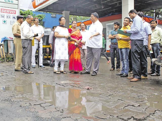 Mayor Snehal Ambekar (in red) surveys the road with a Shiv Sena delegation on Sunday.