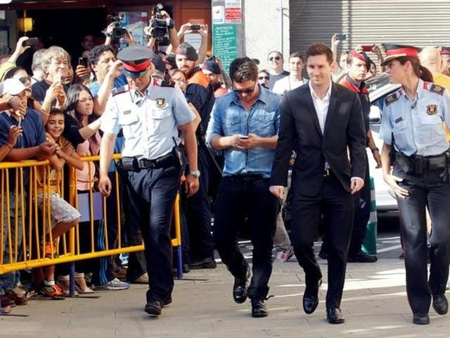 Barcelona's forward Lionel Messi (2nd R) arrives at a court to answer charges of tax evasion in Gava.