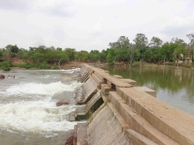 The Baright dam where the Tikamgarh municipal body had employed armed guards to ensure water is not stolen is now overflowing.(HT photo)