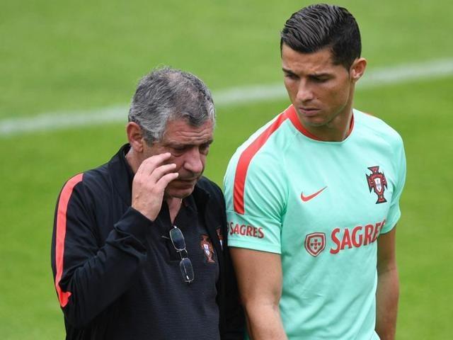Cristiano Ronaldo talks to Portugal coach Fernando Santos during a training session.