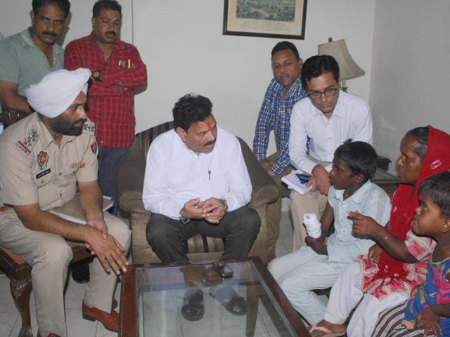 National Commission for Scheduled Castes vice-chairman Raj Kumar Verka interacting with the labourers at Circuit House, Amritsar on Friday.