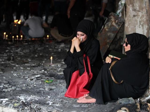 Mourners at the blast site in Baghdad after the Islamic State attack on July 3, in which close to 300 people were killed