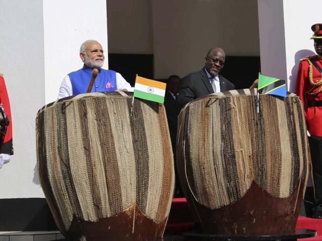 Prime Minister Narendra Modi and Tanzanian President John Pombe Magufuli play drums at the entrance of State House during an official welcome ceremony for Modi in Dar es Salaam, Tanzania , on Sunday, July 10, 2016.