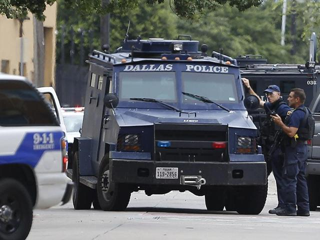 Dallas police respond to reports of a suspicious person in the parking garage of police headquarters in Dallas.