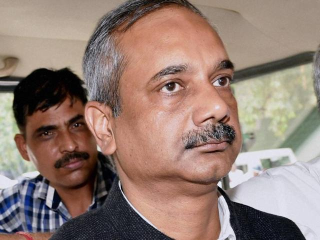 CBI officials bring Rajendra Kumar to the Patiala House court, in New Delhi on Sunday.
