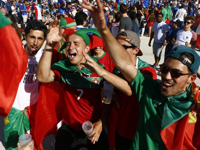 Portuguese supporters chant at the Paris fan zone, hours before the Euro 2016 final.
