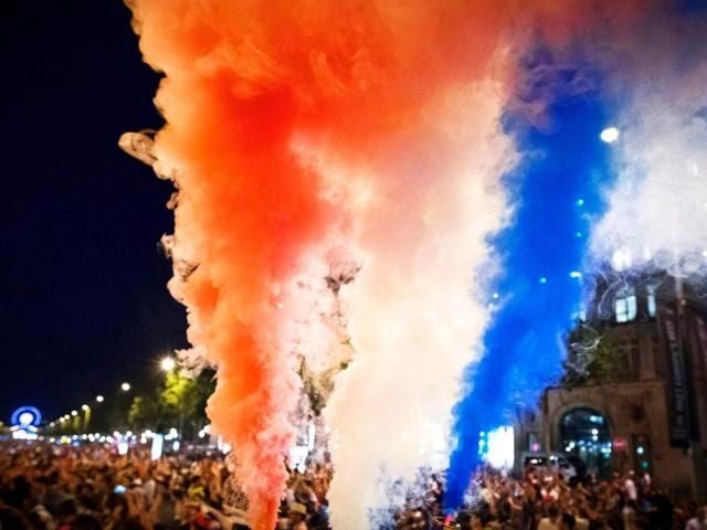 France supporters celebrate with smoke flares after France won the Euro 2016 semi-final football match.