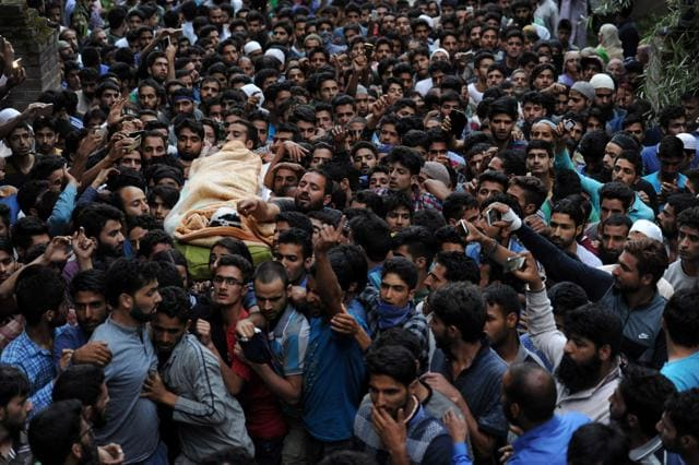 Kashmiri villagers carry the body of Burhan Wani, chief of operations of Indian Kashmir's largest rebel group Hizbul Mujahideen, during his funeral procession in Tral, some 38 Kilometers (24 miles) south of Srinagar.
