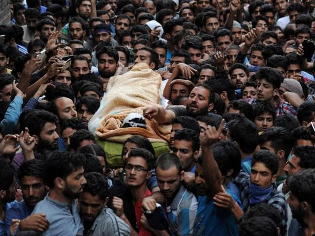 Family members and relatives mourn the death of Burhan Wani, a separatist militant leader, during his funeral in Tral, south of Srinagar, July 9.(REUTERS)
