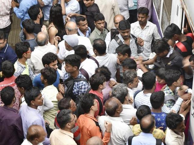File photo of commuters  at Bandra station in Mumbai. , India.  Humanity has expanded exponentially over the past 15 years, with a billion people added since 1999.