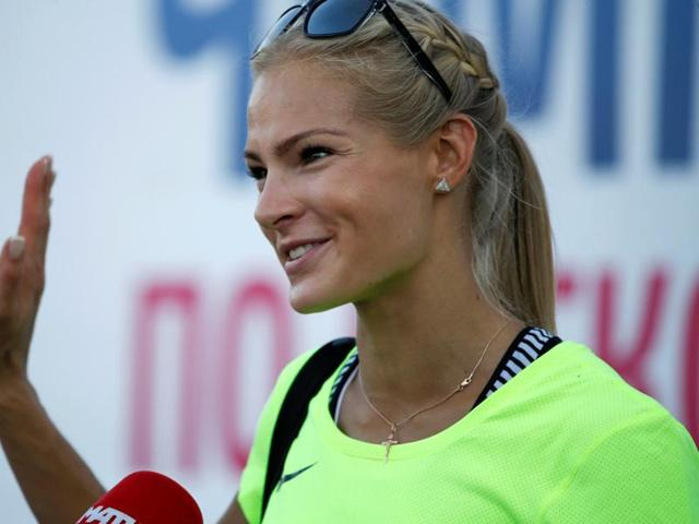Darya Klishina greets supporters in Moscow.