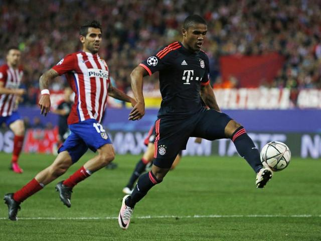 A file photo of Bayern Munich's Brazilian midfielder Douglas Costa playing the ball during the German Cup.