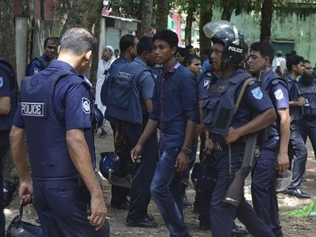 Bangladeshi police detain a suspected militant following an attack near Bangladesh's largest Eid prayer rally in Kishoreganj, some 130kms from Dhaka, on July 7.