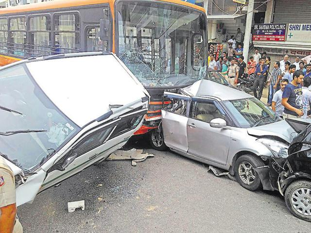 Four people were injured after 11 vehicles, including a cluster bus, piled-up in southwest Delhi's Bijwasan near Kapashera on Monday morning.