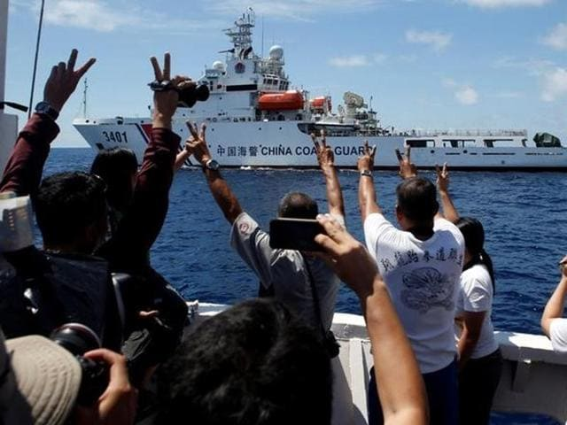 A Chinese Coast Guard vessel manoeuvres to block a Philippine government supply ship with members of the media aboard at the disputed Second Thomas Shoal, part of the Spratly Islands, in the South China Sea in