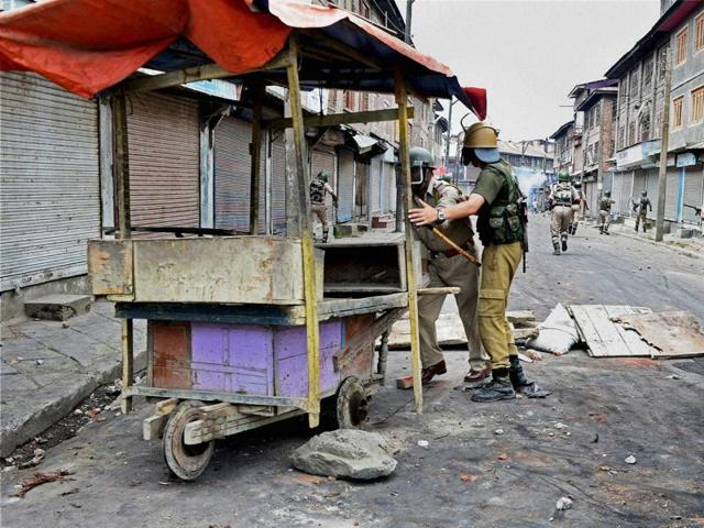 CRPF jawans patrol the streets after clashes with protesters in Srinagar on Sunday.