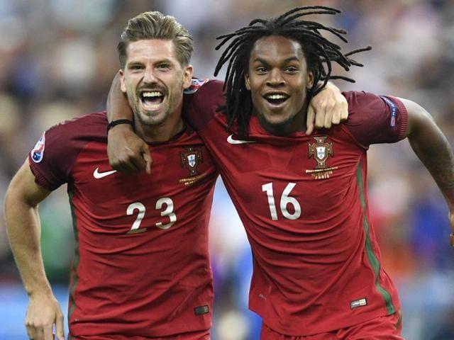 Portugal's midfielder Adrien Silva (L) and Renato Sanches celebrate after Portugal's victory.