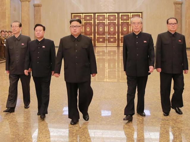 North Korean leader Kim Jong Un (C) visits the Kumsusan Palace of the Sun on the 22nd anniversary of demise of North Korea founder Kim Il Sung in this undated photo released by North Korea's Korean Central News Agency (KCNA) on Friday.