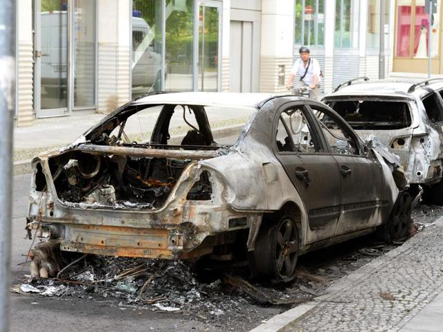 Burned cars stand in Berlin.
