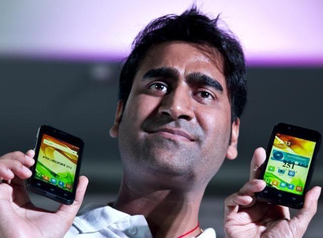 Mohit Goel, director of Ringing Bells Pvt Ltd, with Freedom 251 smartphones, in New Delhi on July 7