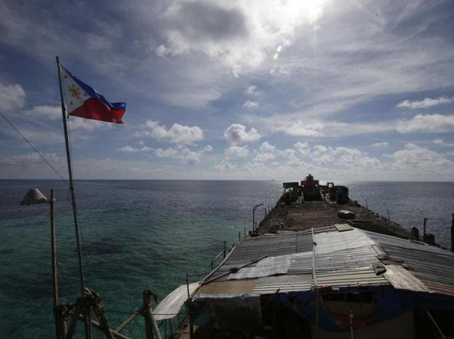 A Chinese Coast Guard vessel manoeuvres to block a Philippine government supply ship with members of the media aboard at the disputed Second Thomas Shoal, part of the Spratly Islands, in the South China Sea in March 2014.