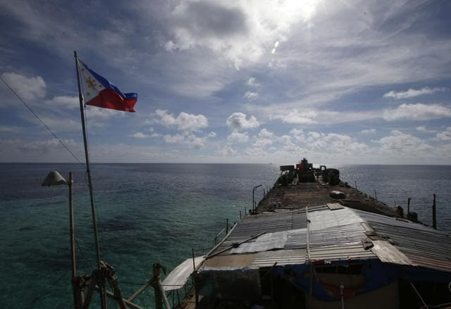 In this photo taken March 29, 2014, a Philippine flag flutters from the deck of the Philippine Navy ship LT 57 Sierra Madre off Second Thomas Shoal in the South China Sea.