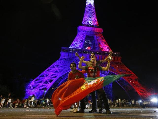 France supporters react during the Euro 2016 final football match loss.