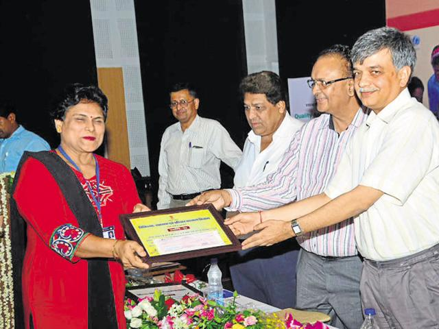 A health worker being felicitated on the occasion of World Population Day on Monday.