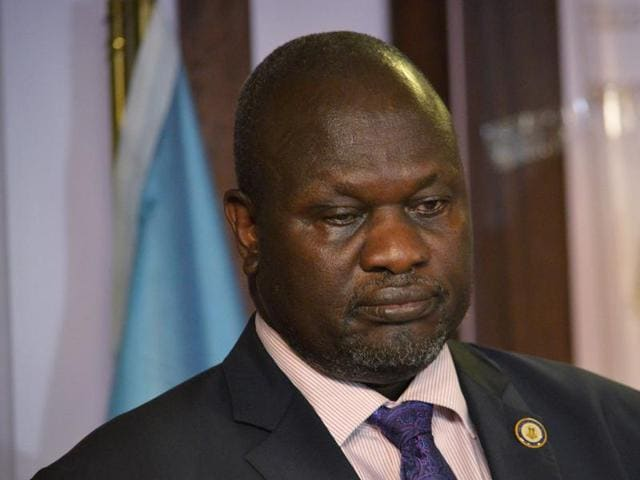 South Sudan first vice-president Riek Machar attends a news conference at the Presidential State House following renewed fighting in South Sudan's capital Juba.