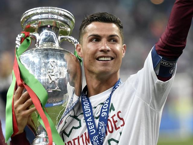 Portugal's Cristiano Ronaldo, right holds the trophy with Ricardo Quaresma after the Euro 2016 final.