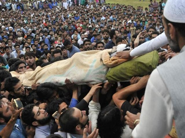 Kashmiris carry the body of Hizb militant  Burhan Wani during funeral procession in his hometown in Tral on Saturday 09 July 2016.